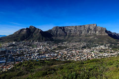Table Mountain view. Table Mountain (Afrikaans: Tafelberg) is a flat-topped mountain forming a prominent landmark overlooking the city of Cape Town in South Royalty Free Stock Photo