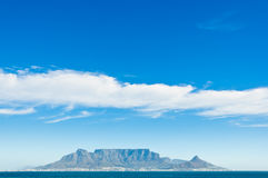 Table Mountain view from Bloubergstrand. A sunny scenic shot of table mountain as seen from bloubergstrand, with  a few scattered clouds Stock Image
