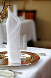 Table napkin. On top of a silver plate stock photos