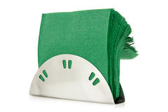 Table napkin holder with green napkins Royalty Free Stock Images