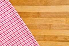 Table napkin. Table kitchen napkin on wooden background Royalty Free Stock Photography