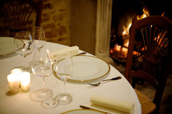 Table near a fireplace Stock Photography