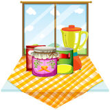A table near the window with foods inside the containers Royalty Free Stock Photography