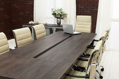 Table for negotiations with the laptop Royalty Free Stock Photo