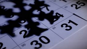 On the table is the New Year`s December calendar on the background of the shadow of a snowflake, the new year 2019. Close-up, season stock footage