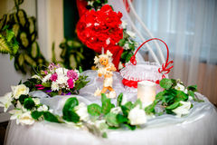 Table for the newlyweds gifts with red flowers. Gifts with red flowers Royalty Free Stock Photography