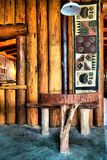 Table next to wooden wall in African restaurant Royalty Free Stock Photography