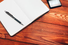 Table with notebook, smartphone and pen Stock Photography