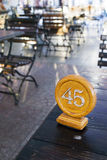 Table number in cafe. Table number 45 in a street cafe Stock Image