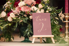 Table number and flower composition Stock Photography