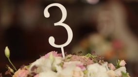 Table numbers at restaurant interior decoration for wedding or birthday with white and blue colors. Holiday floristics stock footage