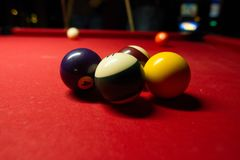 Billiard Balls ready to be hit. A table with numerous billiard balls on red felt Stock Photos