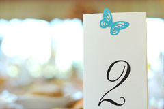 Bordlägga numrerar med fjärilen Royaltyfria Bilder