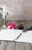 Table with old book Royalty Free Stock Photos