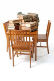 Table and Old Law Books. Wooden chairs around a wooden table full of old torn and worn law books.  Books 70 years old Royalty Free Stock Photography