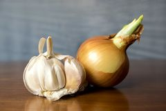 On the table onion and garlic Stock Images