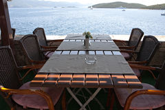 Table in open air restaurant on sea resort Royalty Free Stock Photo