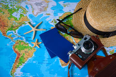 Table with open map showing plans for travelling and related items Royalty Free Stock Image