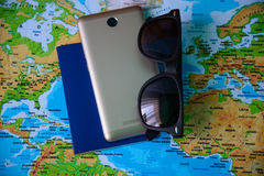 Table with open map showing plans for travelling and related items Royalty Free Stock Images