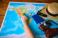 Table with open map showing plans for travelling and related items Stock Images