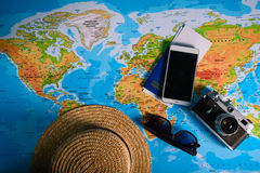 Table with open map showing plans for travelling and related items Stock Photography