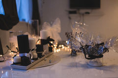 Table ornamentation. Holiday table setting with white candles and bulb garland Royalty Free Stock Images