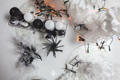 Table ornamentation. Holiday table setting with white candles and bulb garland Royalty Free Stock Photo
