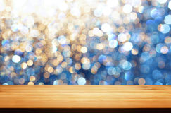 A table in outdoor with blur light spots as background Stock Image