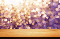 A table in outdoor with purple golden blur light spots as background Royalty Free Stock Photography