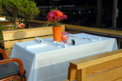 Table for outdoors wedding reception. Table set up outside for wedding reception at an outdoors restaurant Royalty Free Stock Images
