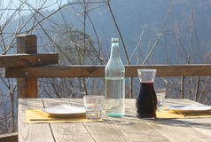 Table outdoors with wine and water. A table with wine and water royalty free stock photos
