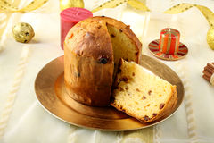Table with panettone and christmas decorations Stock Photos