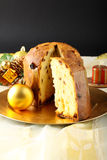Table with panettone and christmas decorations stock photo
