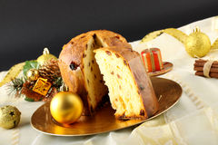 Table with panettone and christmas decorations. On complex background Stock Images