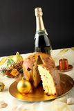 Table with panettone and christmas decorations. On complex background Royalty Free Stock Photo