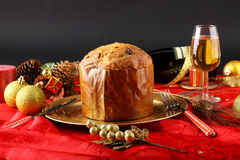 Table with panettone and christmas decorations Stock Photography