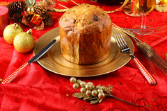 Table with panettone and christmas decorations Stock Images