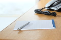 Table and paper Stock Image