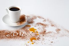 Table after party of new year 2018 with cocoa powder and coffee stock photos