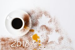 Table after party of new year 2018 with cocoa powder and coffee royalty free stock image