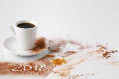 Table after party of new year 2018 with cocoa powder and coffee stock photography