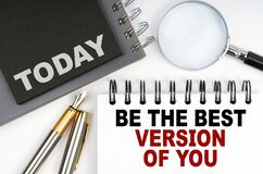 On the table are a pen and notebooks with the words - Today and Be The Best Version Of You