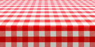 Table perspective view with red checked picnic tablecloth. Table perspective view covered by red checked tablecloth Stock Photo