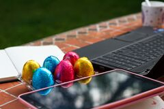 Free Table Photo With Easter Eggs Working From Home By Covid-19. Stock Images - 178656464