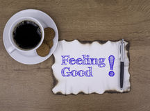 On the table a piece of paper and text. Feeling Good! Royalty Free Stock Photography