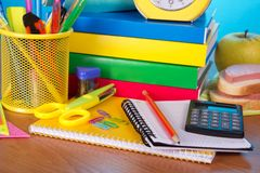 Table piled high with school supplies Royalty Free Stock Photos