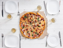 Table with pizza set for four persons Stock Photos