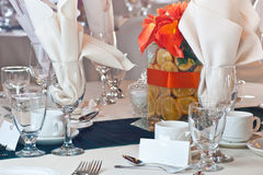 Table place setting with colorful center piece Royalty Free Stock Images
