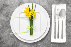 Table place setting cutlery spring flowers decoration Stock Photo