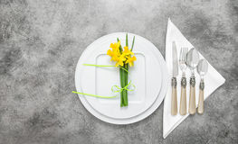 Table place setting cutlery spring flowers decoration Royalty Free Stock Photo